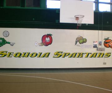 Wall graphics are combination of full color prints and hand painted lettering.